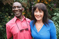 Elderly black man with white woman carer
