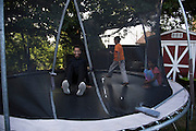 Ahmed Mohamed jumps on the trampoline with his cousins at his home in Irving, Texas on July 15, 2016. (Cooper Neill for The Washington Post)