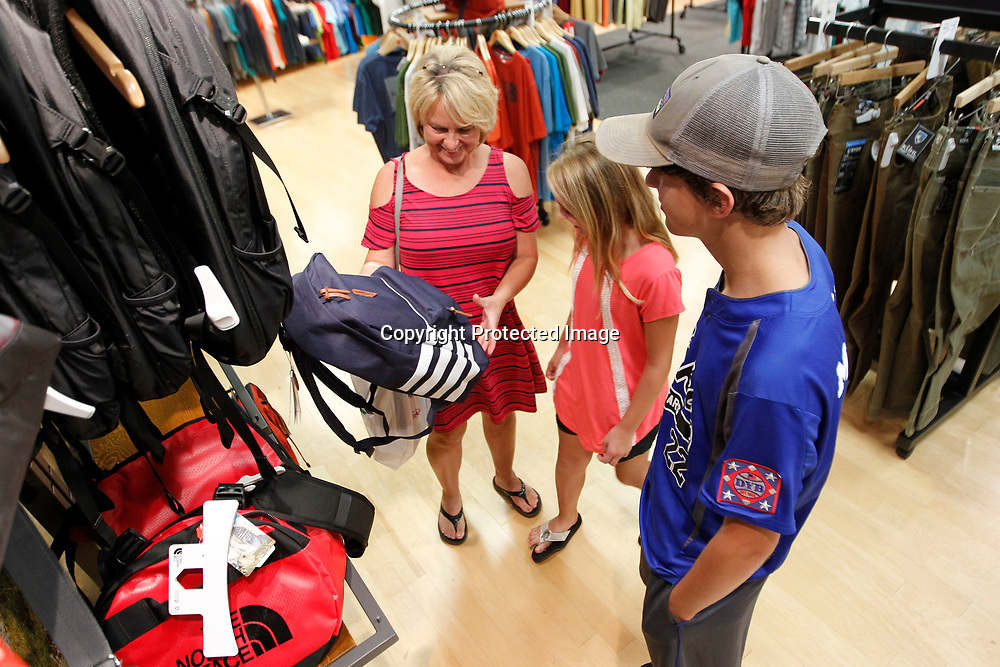 Amy Moore, of Iuka, shops with her children Katelynn, 10, and Josh, 13, at the Mall at Barnes Crossing in Tupelo. The three came to Tupelo on Tuesday to shop and picked up a backpack for Josh at Reed's.