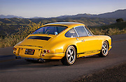 Image of a yellow 1967 Porsche 911 R Tribute car in Solvang, California, American Southwest, model and property released