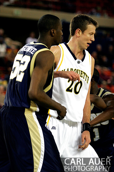 25 November 2005: Golden Eagle Steve Novak (20) posts up on ORU's Yemi Ogunoye in the Marquette University 73-70 victory over Oral Roberts University at the Great Alaska Shootout in Anchorage, Alaska