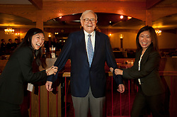 Warren Buffett poses with business students from universities around the country after at lunch at Piccolo Pete's Restaurant in Omaha, Neb., Nov. 11, 2011. Here, Buffett poses with, left to right, Danielle Qi and Patricia Pan of Northwestern University's Kellogg School of Management.