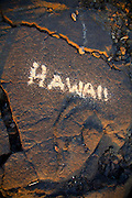 Hawaii sign in sand on lava rock, Makalawena Beach, Kekaha Kai State Park, Kona, Island of Hawaii, Hawaii