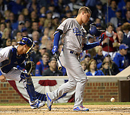 CHICAGO, IL - OCTOBER 22:  Corey Seager #5 of the Los Angeles Dodgers swings and misses at a pitch as his helmet flies off his head on during Game 6 of the NLCS against the Chicago Cubs at Wrigley Field on Saturday, October 22, 2016 in Chicago, Illinois. (Photo by Ron Vesely/MLB Photos via Getty Images) *** Local Caption *** Corey Seager