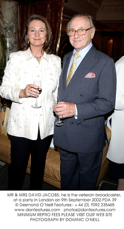 MR & MRS DAVID JACOBS, he is the veteran broadcaster, at a party in London on 9th September 2002.PDA 39