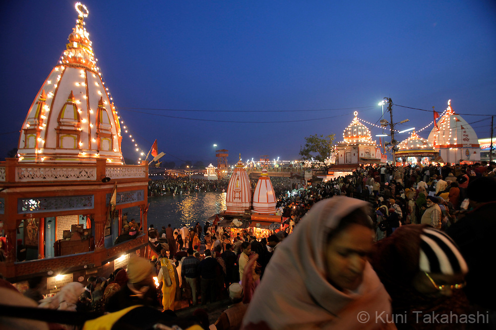 Pilgrims at holy Ganga River in Haridwar, India on Jan 2010 during Kumb Mela, largest Hindu gathering in the world. Hindus believe that bathing in the Ganges during the festival cleanses them of sin.Photo by Kuni Takahashi.