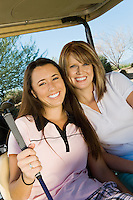 Golfing Friends Sitting in Golf Cart