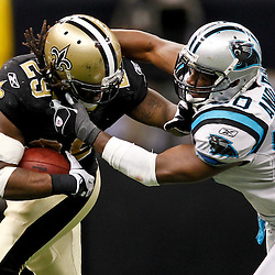 January 1, 2012; New Orleans, LA, USA; New Orleans Saints running back Chris Ivory (29) is grabbed by his deadlocks as Carolina Panthers linebacker James Anderson (50) makes a tackle during the second half of a game at the Mercedes-Benz Superdome. The Saints defeated the Panthers 45-17. Mandatory Credit: Derick E. Hingle-US PRESSWIRE