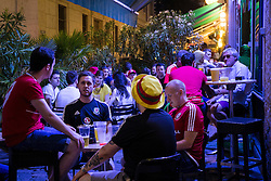 LYON, FRANCE - Tuesday, July 5, 2016: Wales supporters socialise with a drink in a Lyon pub ahead of the UEFA Euro 2016 Championship Semi-Final match against Portugal at the Stade de Lyon. (Pic by Paul Greenwood/Propaganda)