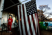 """Helen Sexton unfurled her American Flag and hung it below her house number. She is 89 years now. Helen raised seven children in a shotgun house on Bells Bottom. Back then it was considered one of the poorest areas in Olympia Mill Village. She worked long hours at the mill. """"I didn't raise my children, the good Lord raised them,"""" she said. """"Cuz I worked at the mill from seven in the morning to 11 at night."""" Sexton has witnessed many changes to Olympia. """"I don't know the names of any of my neighbors anymore,"""" she said. """"Just family for me now."""""""