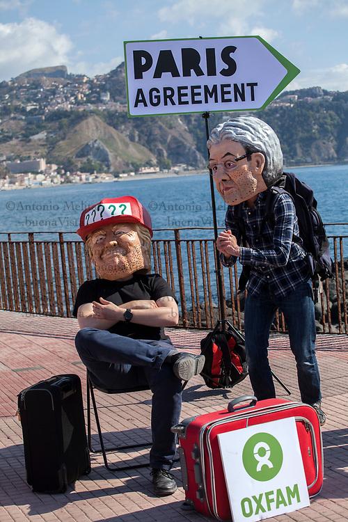 Stunt sull'Accordo di Parigi sul clima organizzato da Oxfam a Giardini Naxos in occasione del G7 di Taormina.