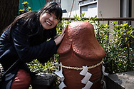 A woman strokes a giant phallus and pose for the cameras during the Kanamara Festival at Kawasaki on April 2, 2017. The Kanamara Matsuri or the festival of the Steel Phallus is held on the first Sunday in April at the Kanayama shrine. The festival started by prostitutes who wished to pray for protection from sexually transmitted diseases, and now for easy delivery, marriage and married-couple harmony. It become a tourist attraction and is used to rise money for HIV disease. 02/04/2017-Kawasaki, JAPAN