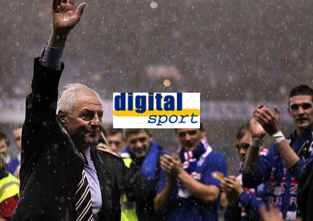 Football - Scottish Premier League - Rangers vs Dundee United<br /> <br /> Rangers manager Walter Smith walks round the pitch taking the applause of the fans after his last home game in charge of Rangers at the end of the Rangers vs Dundee United Clydesdale Bank Premier league match at Ibrox Stadium