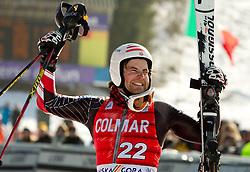 Second placed Nolan Kasper of USA celebrates during flower ceremony after the Men's Slalom of FIS Ski World Cup Alpine Kranjska Gora, on March 6, 2011 in Vitranc/Podkoren, Kranjska Gora, Slovenia.  (Photo By Vid Ponikvar / Sportida.com)