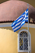 Corfiot flag of blue and white stripes by church chapel in Perithia, Northern Corfu, Ionian Islands, Greece