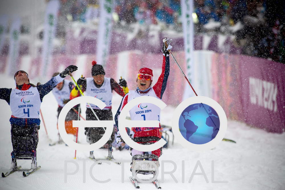 Cross-country Skiing: 2014 Sochi Winter Paralympics: Mariann Marthinsen of Norway crosses the finish line to win Gold in the women's 1km Sitting Cross-Country Skiing at the Laura Cross-Country Ski and Biathlon Center, Sochi, Russia 10/03/2014;<br /> PHOTO CREDIT: &copy; George S Blonsky