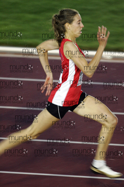 (Sherbrooke, Canada---22 July 2006) Natalie Geiger competing in the 200m qualifying rounds at  the 2006 Canadian Junior Track and Field Championships and national multi-events championships 21-23 July 2006 held in Sherbrooke Quebec. Copyright 2006 Sean Burges / Mundo Sport Images, www.mundosportimages.com