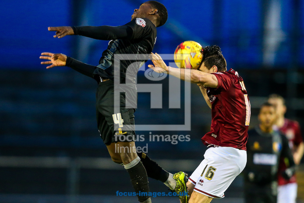 David Buchanan of Northampton Town (right) heads clear under pressure from Mitch Rose of Mansfield Town  (left) during the Sky Bet League 2 match at Sixfields Stadium, Northampton<br /> Picture by Andy Kearns/Focus Images Ltd 0781 864 4264<br /> 14/11/2015