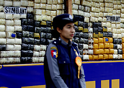 June 26, 2017 - A policemwoman stands next to seized drugs to be burnt in Yangon. Myanmar authorities ceremonially burned 25 kinds of seized narcotic drugs in Yangon on Monday to mark the International Day against Drug Abuse and Illicit Trafficking. (Credit Image: © U Aung/Xinhua via ZUMA Wire)