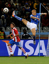 14.06.2010, Cape Town Stadium, Kapstadt, RSA, FIFA WM 2010, Italien vs Paraguay im Bild Fabio Cannavaro (Italia) e Enrique Vera (Paraguay), EXPA Pictures © 2010, PhotoCredit: EXPA/ InsideFoto/ G. Perottino, ATTENTION! FOR AUSTRIA AND SLOVENIA ONLY!!! / SPORTIDA PHOTO AGENCY