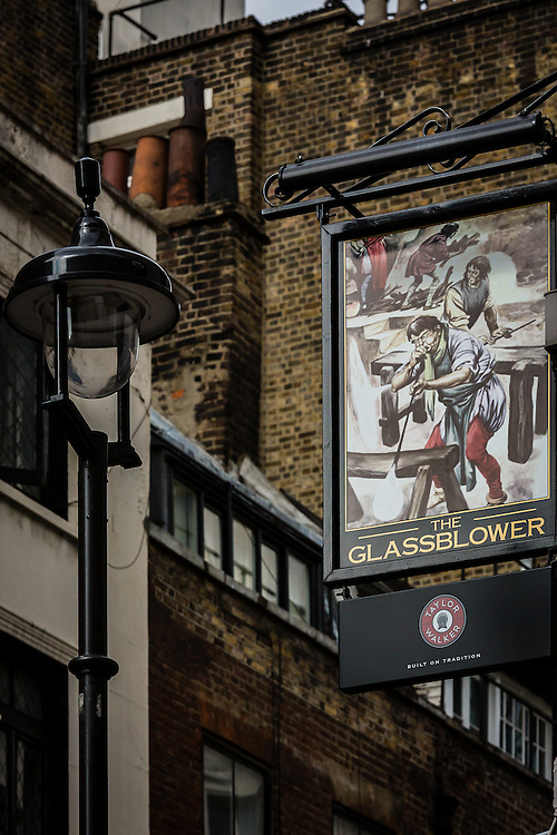One of the many typical colorful pub signs in London
