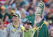 A pair of Green Bay Packers fans wear team gear, one of whom dons what looks like a bishop's robe and head gear bearing the likeness of Vince Lombardi, before the Green Bay Packers 2016 NFL Pro Football Hall of Fame preseason football game against the Indianapolis Colts on Sunday, Aug. 7, 2016 in Canton, Ohio. The game was canceled for player safety reasons due to the condition of the paint on the turf field. (©Paul Anthony Spinelli)