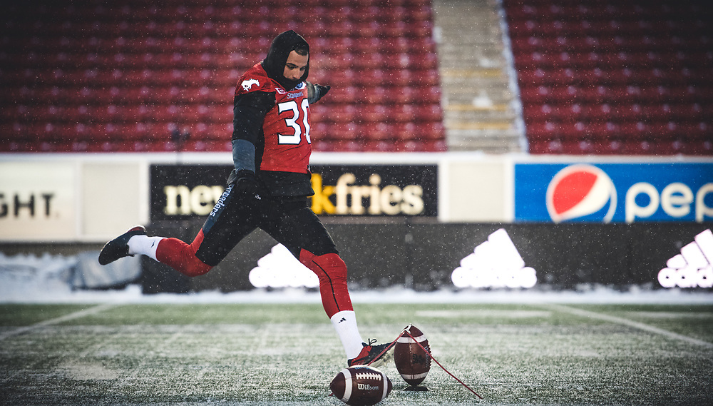 Rene Paredes (30) of the Calgary Stampeders warms up before the game against the Winnipeg Blue Bombers at McMahon Stadium in Calgary, AB, Friday Nov. 3, 2017. (Photo: Johany Jutras)