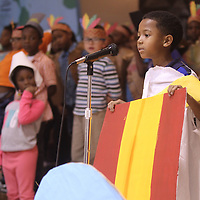 "Adam Robison | BUY AT PHOTOS.DJOURNAL.COM<br /> Kahleb Sykes, a first grader at Verona Elementary School, represents the country of Rome as he tells its history of Thanksgiving during the ""Thanksgiving Around The World"" program at Verona Elementary School Thursday afternoon."