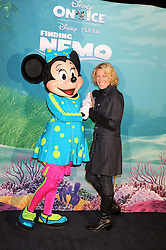 "CERYS MATTHEWS photographed with Minnie Mouse at a VIP Opening night of Disney & Pixar's ""Finding Nemo on Ice"" at The O2 Arena Grennwich London on 23rd October 2008."
