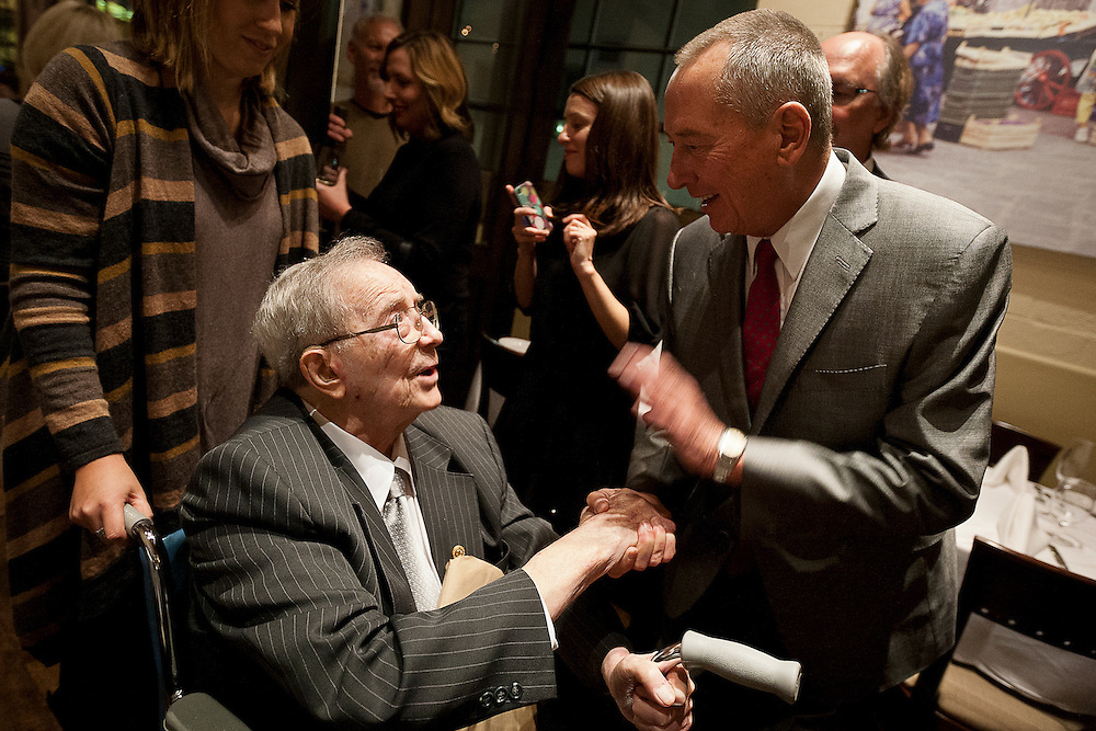 Screenwriter Barry Morrow, right, shakes hands with Fran Peek, father of at noted savant Kim Peek, popularized by the film 'Rain Man' at Valter Osteria Restaurant, Friday, Nov. 9, 2012.