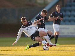 Falkirk's Mark Millar and Dundee's Nicolas Riley. Dundee 1 v 1 Falkirk, Scottish Championship game at Dundee's home ground Dens Park.