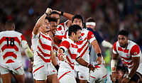Rugby Union - 2019 Rugby World Cup - Pool A: Japan vs. Scotland<br /> <br /> Yu Tamura, Rikiya Matsuda and Ryohei Yamanaka of Japan celebrate at full time at International Stadium Yokohama, Kanagawa Prefecture, Yokohama City.<br /> <br /> COLORSPORT/LYNNE CAMERON