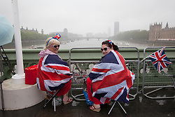 © Licensed to London News Pictures. 03/06/2012. London, UK. The Royal Jubilee celebrations.  Sue Ridley and Karen Ridley waiting for the Thames Diamond Jubilee Pageant on Westminster Bridge as Great Britain is celebrating the 60th anniversary of the countries Monarch HRH Queen Elizabeth II accession to the throne this weekend. Photo credit : Tolga Akmen/LNP
