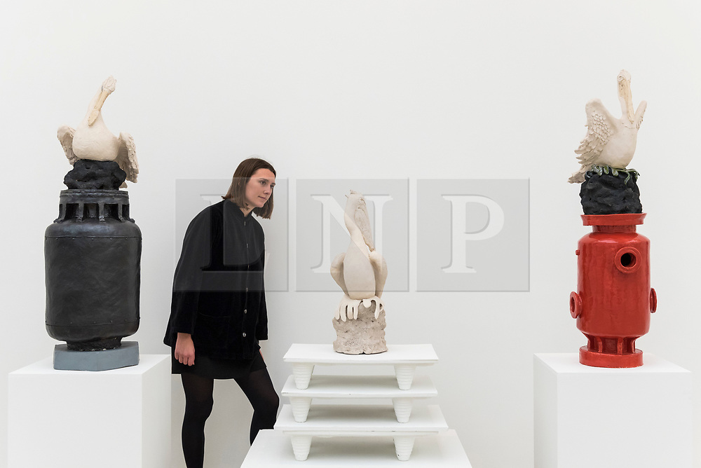 """© Licensed to London News Pictures. 14/03/2019. LONDON, UK. A staff member views """"Pelican Bay"""", 2012, by Benedetto Pietromarchi. Preview of Kaleidoscope, a new exhibition at the Saatchi Gallery featuring the work of 9 contemporary artists.  The show runs 15 March to 5 May 2019.  Photo credit: Stephen Chung/LNP"""