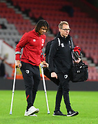 Nathan Ake (5) of AFC Bournemouth on crutches as he walk across the pitch at the end of the match during the Premier League match between Bournemouth and Liverpool at the Vitality Stadium, Bournemouth, England on 7 December 2019.