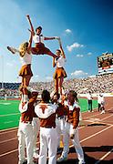 Cheerleaders at football game, University of Texas, Austin, TX.