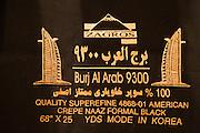 Bur Dubai Souq. Burj Al Arab textile.