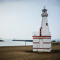 Photo of the New Buffalo city beach lighthouse in New Buffalo Michigan with Lake Michigan.