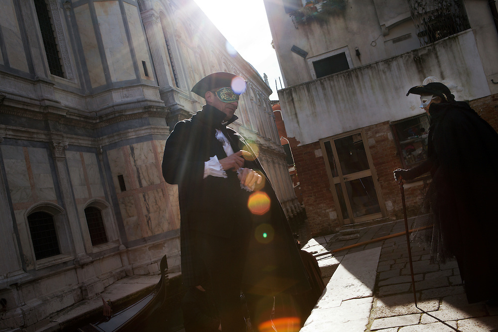 People dressed in traditional costume in Venice during the carnival.