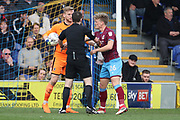 Ref stepping between AFC Wimbledon goalkeeper George Long (1) and Scunthorpe United midfielder Cameron McGeehan (26) during the EFL Sky Bet League 1 match between AFC Wimbledon and Scunthorpe United at the Cherry Red Records Stadium, Kingston, England on 7 April 2018. Picture by Matthew Redman.