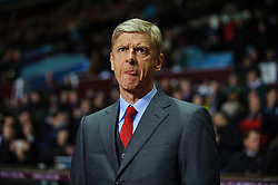 Arsenal Manager Arsene Wenger (FRA) sticks his tongue out as he stands in the dugout before the match - Photo mandatory by-line: Rogan Thomson/JMP - Tel: Mobile: 07966 386802 - 13/01/2014 - SPORT - FOOTBALL - Villa Park, Birmingham - Aston Villa v Arsenal  - Barclays Premier League.