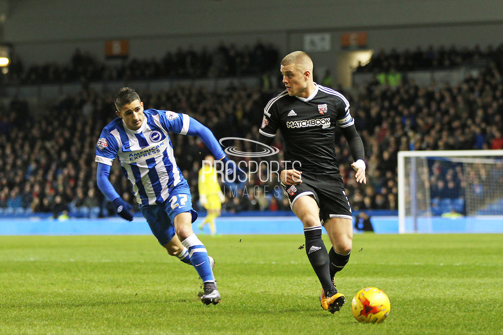 Brentford defender Jake Bidwell is watched by Brighton striker, Anthony Knockaert (27) during the Sky Bet Championship match between Brighton and Hove Albion and Brentford at the American Express Community Stadium, Brighton and Hove, England on 5 February 2016. Photo by Geoff Penn.