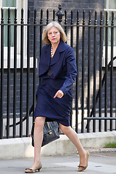 "© Licensed to London News Pictures. 29/08/2013. London, UK. The Home Secretary Theresa May arrives for a meeting of the British cabinet on Downing Street in London today (29/08/2013) as a recalled British Parliament prepares to debate the possibility of ""direct"" military action over recent reports an alleged chemical weapons attack in Syria. Photo credit: Matt Cetti-Roberts/LNP"