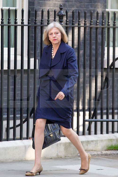 """© Licensed to London News Pictures. 29/08/2013. London, UK. The Home Secretary Theresa May arrives for a meeting of the British cabinet on Downing Street in London today (29/08/2013) as a recalled British Parliament prepares to debate the possibility of """"direct"""" military action over recent reports an alleged chemical weapons attack in Syria. Photo credit: Matt Cetti-Roberts/LNP"""