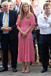 © Licensed to London News Pictures. 24/07/2019. London, UK. Carrie Symonds watches her partner, newly elected conservative party leader and British Prime Minister Boris Johnson MP make a speech outside No.10 Downing Street before ehtering office.   Photo credit: Ray Tang/LNP