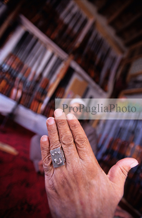 Kabul, 14 August 2005..In a local gun's shop, a Pakistani proudly show his ring..