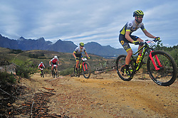 PAARL SOUTH AFRICA - MARCH 23: Riders on the 70km final day, stage 7 on March 23, 2018 Wellingtion to Paarl, South Africa. Mountain bikers gather from around the world to compete in the 2018 ABSA Cape Epic, racing 8 days and 658km across the Western Cape with an accumulated 13 530m of climbing ascent, often referred to as the 'untamed race' the Cape Epic is said to be the toughest mountain bike event in the world. (Photo by Dino Lloyd)