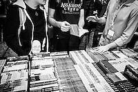 """NAPOLI, 24 APRILE 2016: Un venditore discute del manga """"Assassination Classroom"""" con dei ragazzi durante la XVIII edizione di Comicon, il salone internazionale del fumetto a Napoli, il 24 aprile 2016.<br /> <br /> ###<br /> <br /> NAPLES, ITALY - 24 APRIL 2016: A seller talks about """"Assassination Classroom"""" with teenagers at the XVIII edition of Comicon, the international comics fair in Naples, Italy, on April 24th 2016."""
