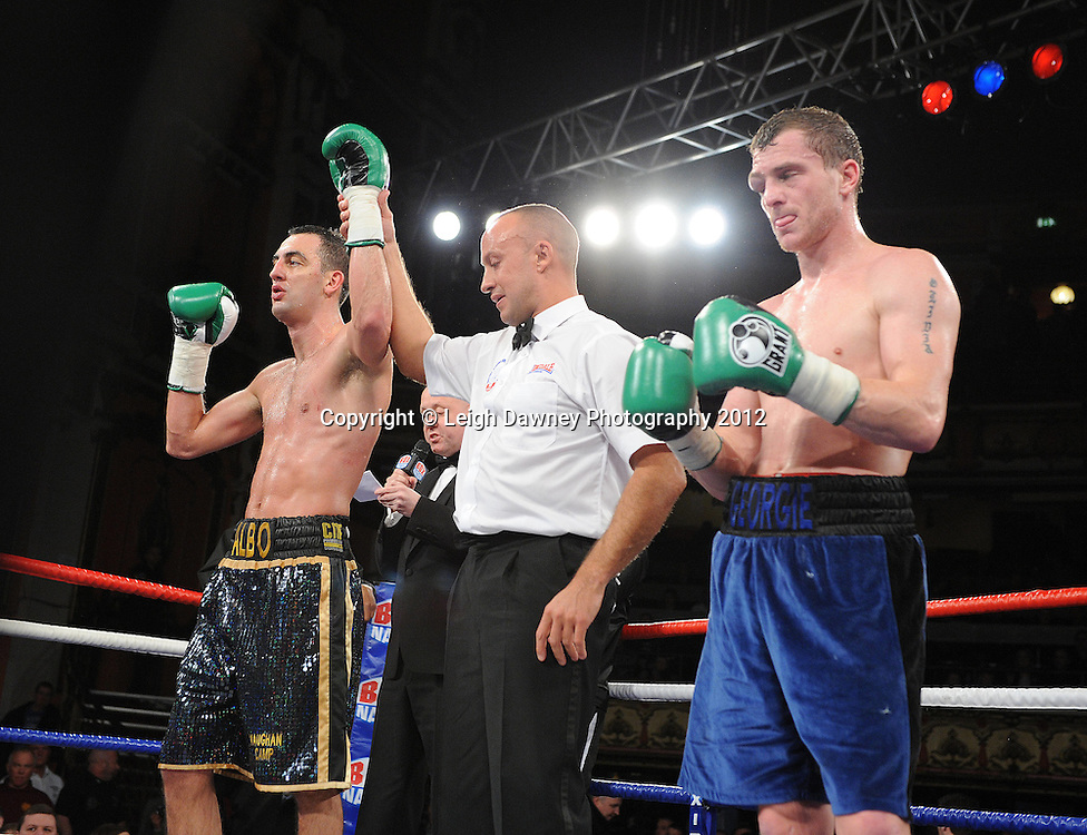 Joe Selkirk (black shorts) defeats Ryan Toms in a 8x3min Light Middleweight contest at Olympia, Liverpool on the 20th January 2012. Vaughan Boxing Promotions. © Leigh Dawney Photography 2012.