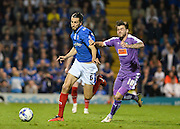Portsmouth defender Christian Burgess and Plymouth midfielder Graham Carey during the Sky Bet League 2 play-off first leg match between Portsmouth and Plymouth Argyle at Fratton Park, Portsmouth, England on 12 May 2016. Photo by Adam Rivers.